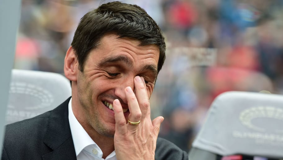 Leverkusen's head coach Tayfun Korkut is pictured during the German first division football match between Hertha Berlin and Bayer 04 Leverkusen in Berlin, on May 20, 2017. / AFP PHOTO / TOBIAS SCHWARZ / RESTRICTIONS: DURING MATCH TIME: DFL RULES TO LIMIT THE ONLINE USAGE TO 15 PICTURES PER MATCH AND FORBID IMAGE SEQUENCES TO SIMULATE VIDEO. == RESTRICTED TO EDITORIAL USE == FOR FURTHER QUERIES PLEASE CONTACT DFL DIRECTLY AT + 49 69 650050  / RESTRICTIONS: DURING MATCH TIME: DFL RULES TO LIMIT THE ONLINE USAGE TO 15 PICTURES PER MATCH AND FORBID IMAGE SEQUENCES TO SIMULATE VIDEO. == RESTRICTED TO EDITORIAL USE == FOR FURTHER QUERIES PLEASE CONTACT DFL DIRECTLY AT + 49 69 650050         (Photo credit should read TOBIAS SCHWARZ/AFP/Getty Images)