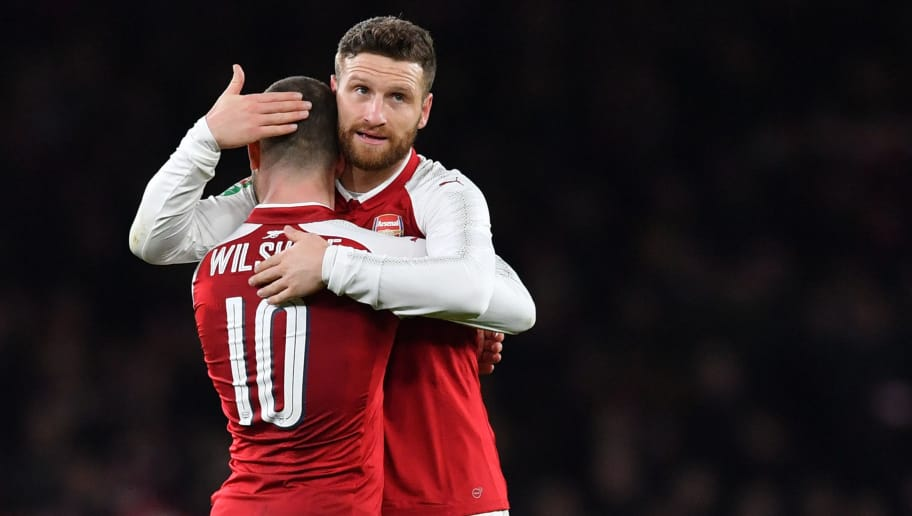 Arsenal's German defender Shkodran Mustafi (R) and Arsenal's English midfielder Jack Wilshere gesture at the final whistle during the League Cup semi-final football match between Arsenal and Chelsea at the Emirates Stadium in London on January 24, 2018.  / AFP PHOTO / Ben STANSALL / RESTRICTED TO EDITORIAL USE. No use with unauthorized audio, video, data, fixture lists, club/league logos or 'live' services. Online in-match use limited to 75 images, no video emulation. No use in betting, games or single club/league/player publications.  /         (Photo credit should read BEN STANSALL/AFP/Getty Images)