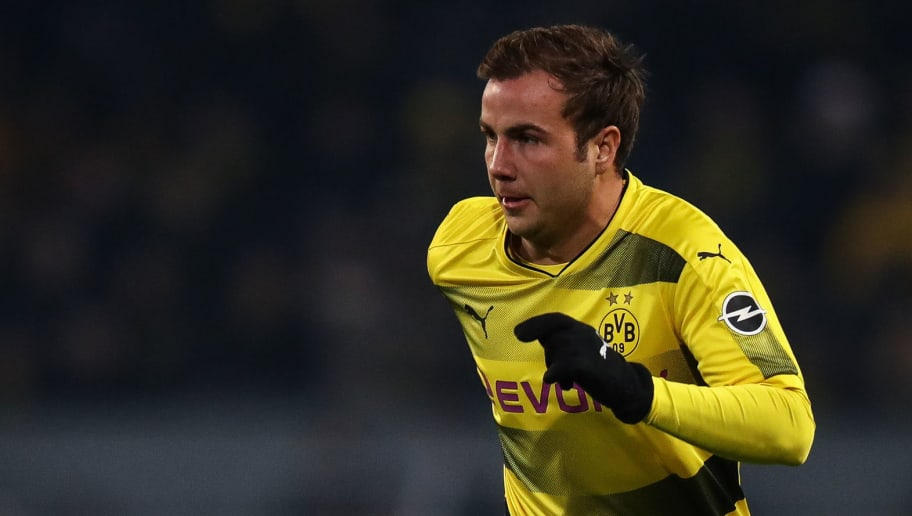 DORTMUND, GERMANY - JANUARY 14: Mario Gotze #10 of Borussia Dortmund controls the ball during the Bundesliga match between Borussia Dortmund and VfL Wolfsburg at Signal Iduna Park on January 14, 2018 in Dortmund, Germany. (Photo by Maja Hitij/Bongarts/Getty Images)