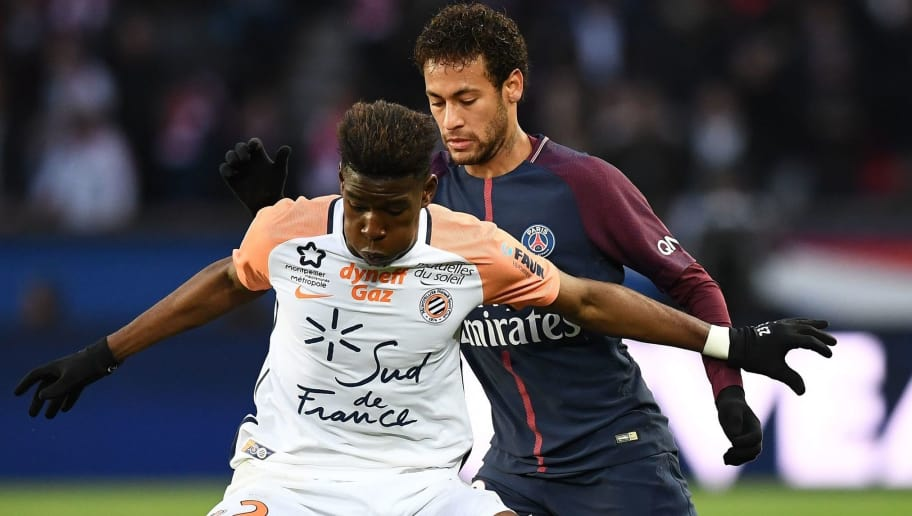 Montpellier's French defender Nordi Mukiele (C) vies with Paris Saint-Germain's Brazilian forward Neymar during the French L1 football match between Paris Saint-Germain (PSG) and Montpellier (MHSC) at the Parc des Princes stadium in Paris on January 27, 2018. / AFP PHOTO / FRANCK FIFE        (Photo credit should read FRANCK FIFE/AFP/Getty Images)