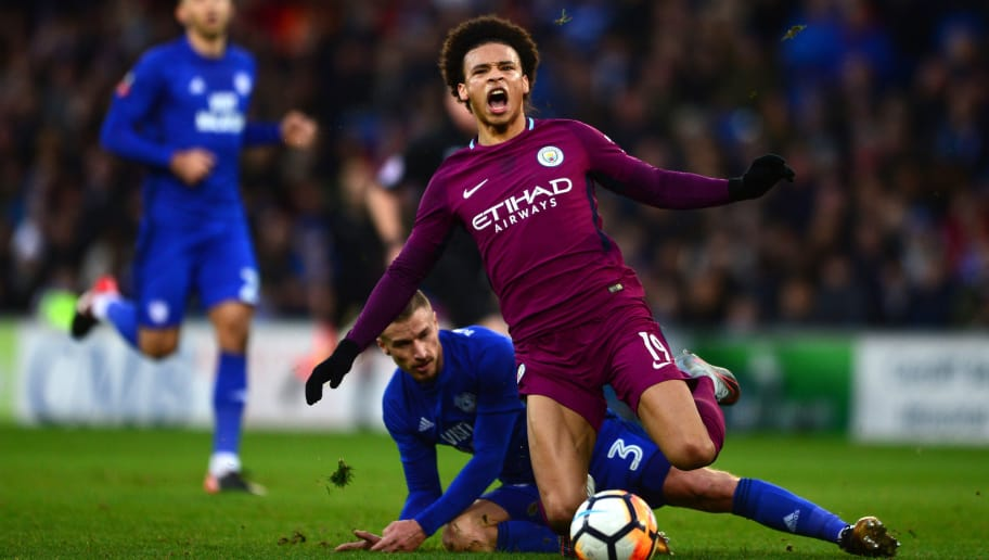 CARDIFF, WALES - JANUARY 28:  Leroy Sane of Manchester City is tackled by Joe Bennett of Cardiff City during The Emirates FA Cup Fourth Round between Cardiff City and Manchester City on January 28, 2018 in Cardiff, United Kingdom.  (Photo by Harry Trump/Getty Images)