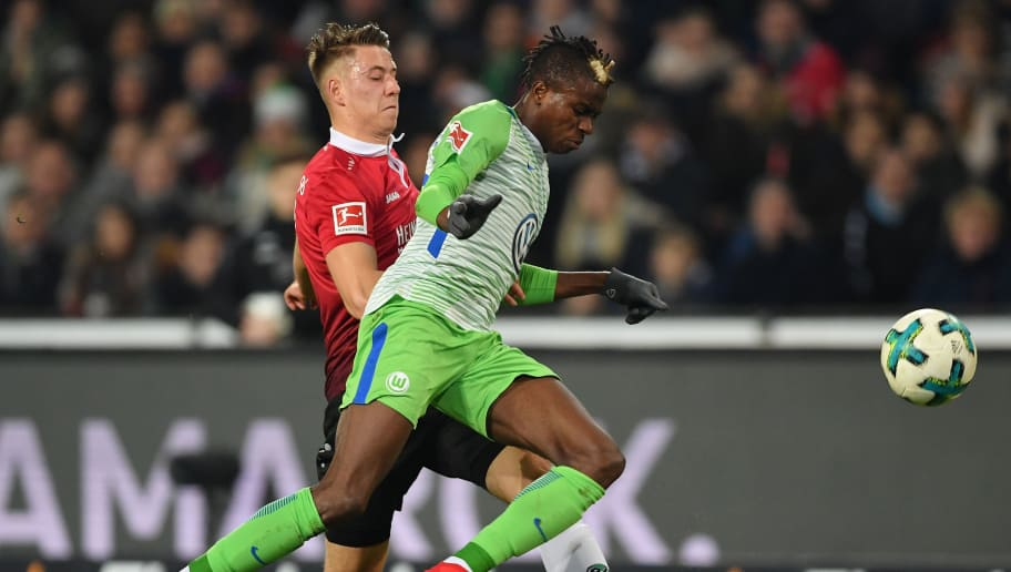 HANOVER, GERMANY - JANUARY 28:  Victor Osimhen of Wolfsburg is challenged by Waldemar Anton of Hannover during the Bundesliga match between Hannover 96 and VfL Wolfsburg at HDI-Arena on January 28, 2018 in Hanover, Germany.  (Photo by Stuart Franklin/Bongarts/Getty Images)