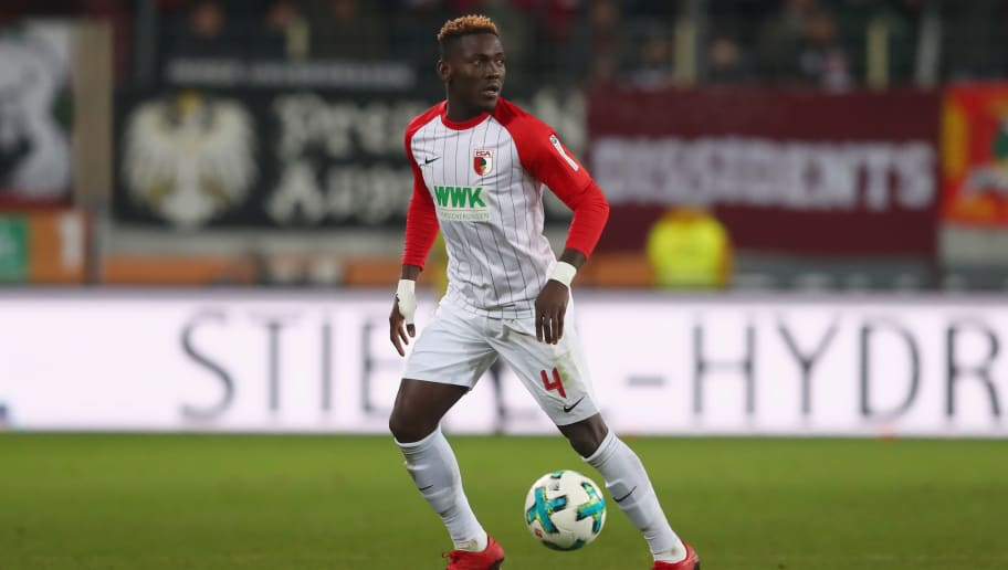 AUGSBURG, GERMANY - NOVEMBER 25:  Daniel Opare of Augsburg runs with the ball during the Bundesliga match between FC Augsburg and VfL Wolfsburg at WWK-Arena on November 25, 2017 in Augsburg, Germany.  (Photo by Alexander Hassenstein/Bongarts/Getty Images)