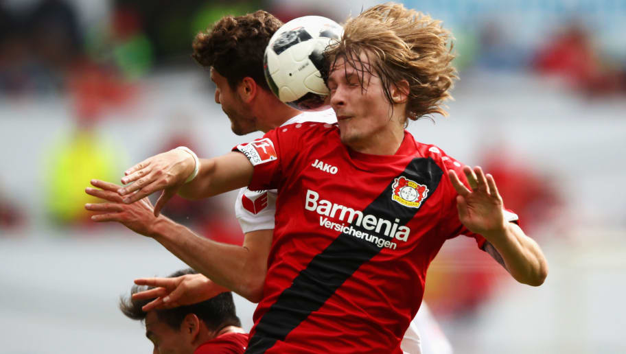 LEVERKUSEN, GERMANY - MAY 13:  Tin Jedvaj of Bayer 04 Leverkusen challenges for the headed ball with Jonas Hector of Koeln during the Bundesliga match between Bayer 04 Leverkusen and 1. FC Koeln at BayArena on May 13, 2017 in Leverkusen, Germany.  (Photo by Dean Mouhtaropoulos/Bongarts/Getty Images)