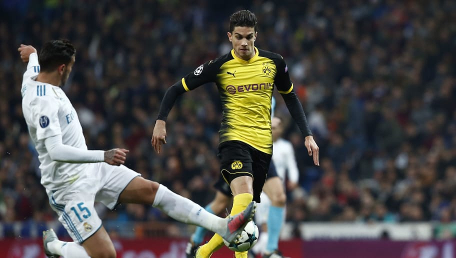 MADRID, SPAIN - DECEMBER 06: Hernandez Theo of Real Madrid tackles Marc Bartra of Borussia Dortmund during the UEFA Champions League group H match between Real Madrid and Borussia Dortmund at Estadio Santiago Bernabeu on December 6, 2017 in Madrid, Spain.  (Photo by Gonzalo Arroyo Moreno/Getty Images)