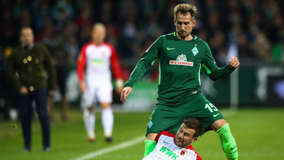 BREMEN, GERMANY - OCTOBER 29: Daniel Baier of Augsburg (L) and Izet Hajrovic of Bremen battle for the ball during the Bundesliga match between SV Werder Bremen and FC Augsburg at Weserstadion on October 29, 2017 in Bremen, Germany. (Photo by Martin Rose/Bongarts/Getty Images)