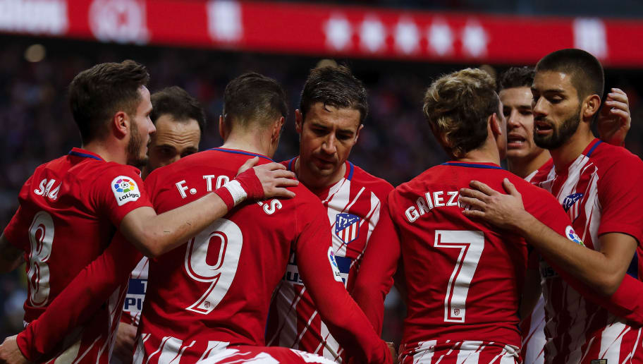 MADRID, SPAIN - JANUARY 28: Fernando Torres (3dL) of Atletico de Madrid celebrates scoring their second goal with teammate Saul Niguez (L); Juan Francisco Torres alias Juanfran (2ndL), Gabi Fernandez (4thL);  Antoine Griezmann (3dR) and Yannick Carrasco (R) during the La Liga match between Club Atletico Madrid and UD Las Palmas at Estadio Wanda Metropolitano on January 28, 2018 in Madrid, Spain. (Photo by Gonzalo Arroyo Moreno/Getty Images)