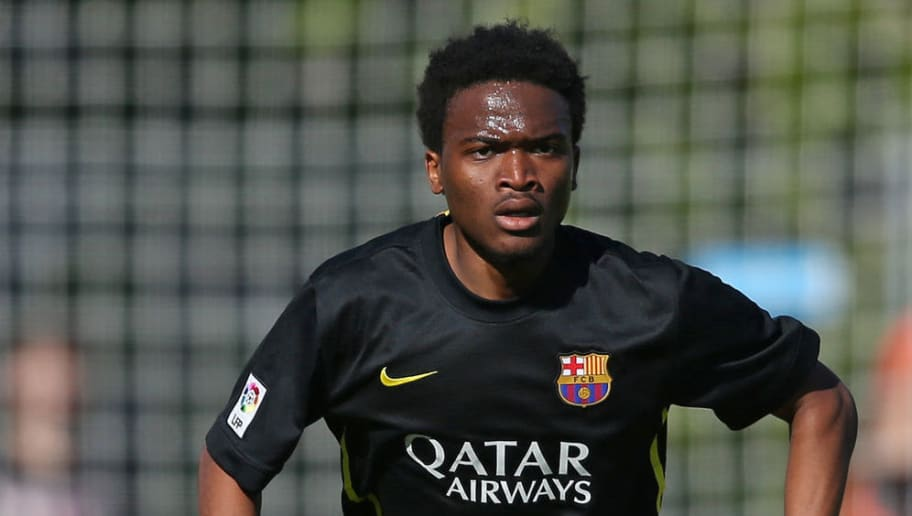 NYON, SWITZERLAND - APRIL 14: Wilfrid Kaptoum of FC Barcelona runs with the ball during the UEFA Youth League Final match between Benfica Lisbon and FC Barcelona at Colovray Stadion on April 14, 2014 in Nyon, Switzerland. (Photo by Philipp Schmidli/Getty Images)