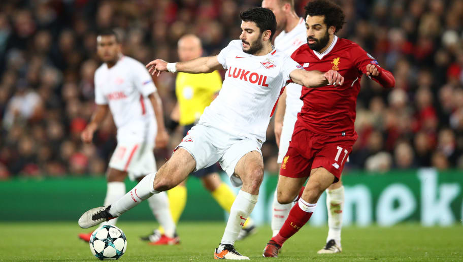LIVERPOOL, ENGLAND - DECEMBER 06:  Serdar Tasci of Spartak Moskva is challenged by Mohamed Salah of Liverpool during the UEFA Champions League group E match between Liverpool FC and Spartak Moskva at Anfield on December 6, 2017 in Liverpool, United Kingdom.  (Photo by Clive Brunskill/Getty Images)