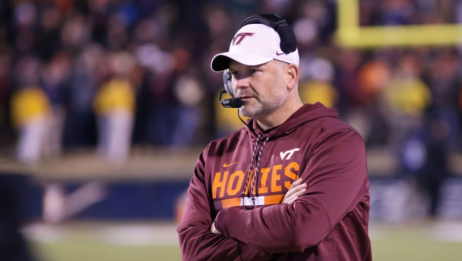 CHARLOTTESVILLE, VA - NOVEMBER 24: Head coach Justin Fuente of the Virginia Tech Hokies watches a play in the third quarter during a game against the Virginia Cavaliers at Scott Stadium on November 24, 2017 in Charlottesville, Virginia. Virginia Tech defeated Virginia 10-0. (Photo by Ryan M. Kelly/Getty Images)