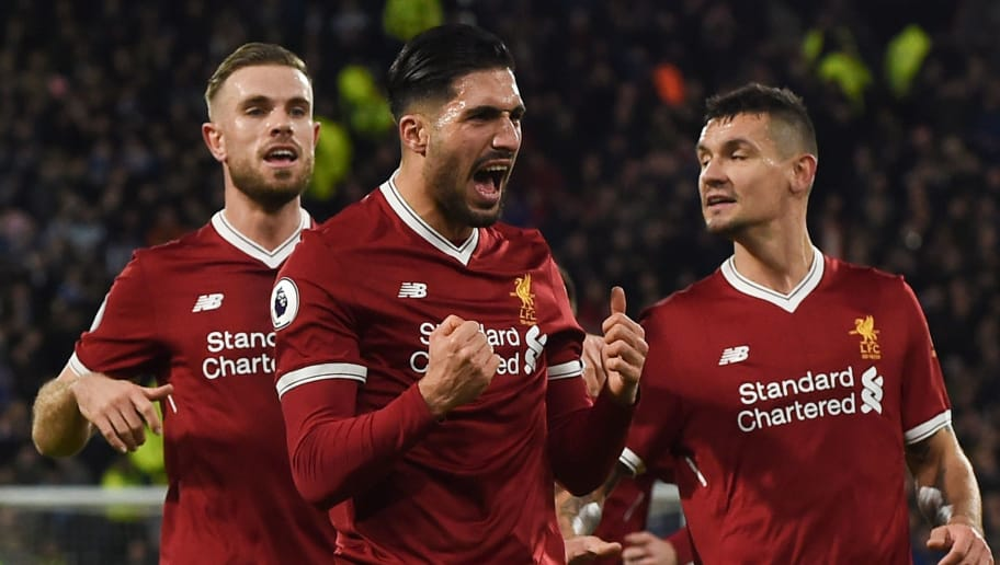 Liverpool's German midfielder Emre Can (C) celebrates scoring the opening goal during the English Premier League football match between Huddersfield Town and Liverpool at the John Smith's stadium in Huddersfield, northern England on January 30, 2018. / AFP PHOTO / PAUL ELLIS / RESTRICTED TO EDITORIAL USE. No use with unauthorized audio, video, data, fixture lists, club/league logos or 'live' services. Online in-match use limited to 75 images, no video emulation. No use in betting, games or single club/league/player publications.  /         (Photo credit should read PAUL ELLIS/AFP/Getty Images)