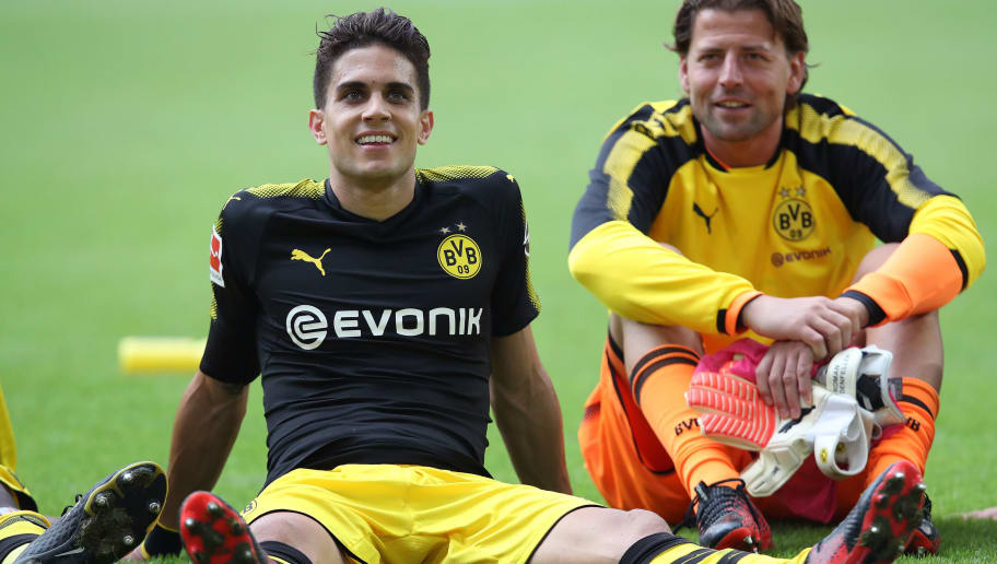 WOLFSBURG, GERMANY - AUGUST 19: Marc Bartra (L) of Dortmund sits on the pitch next to goalkeeper Roman Weidenfeller (R) of Dortmund after the Bundesliga match between VfL Wolfsburg and Borussia Dortmund at Volkswagen Arena on August 19, 2017 in Wolfsburg, Germany. (Photo by Ronny Hartmann/Bongarts/Getty Images)