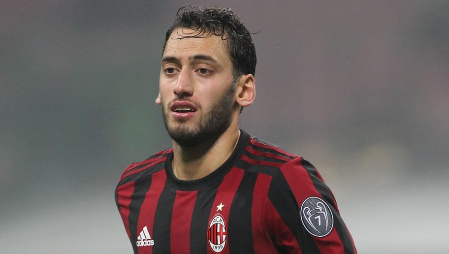 MILAN, ITALY - JANUARY 06:  Hakan Calhanoglu of AC Milan looks on during the serie A match between AC Milan and FC Crotone at Stadio Giuseppe Meazza on January 6, 2018 in Milan, Italy.  (Photo by Marco Luzzani/Getty Images)