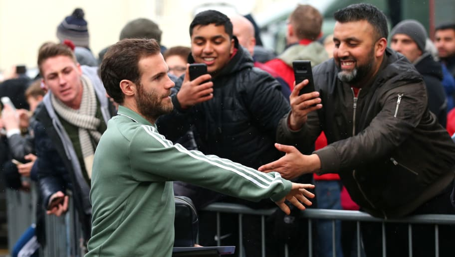 BURNLEY, ENGLAND - JANUARY 20:  Juan Mata of Manchester United shakes hands with hands as he arrives prior to the Premier League match between Burnley and Manchester United at Turf Moor on January 20, 2018 in Burnley, England.  (Photo by Alex Livesey/Getty Images)