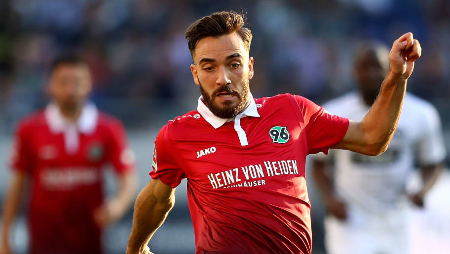 HANOVER, GERMANY - OCTOBER 14:  Kenan Karaman of Hannover runs with the ball during the Bundesliga match between Hannover 96 and Eintracht Frankfurt at HDI-Arena on October 14, 2017 in Hanover, Germany.  (Photo by Martin Rose/Bongarts/Getty Images)
