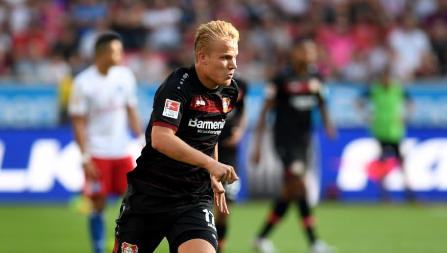 Leverkusen's midfielder Joel Pohjanpalo vies for the ball during German first division Bundesliga football match between Bayer 04 Leverkusen and Hamburger SV in the Bay Arena in Leverkusen, western Germany on September 10, 2016. / AFP / PATRIK STOLLARZ / RESTRICTIONS: DURING MATCH TIME: DFL RULES TO LIMIT THE ONLINE USAGE TO 15 PICTURES PER MATCH AND FORBID IMAGE SEQUENCES TO SIMULATE VIDEO. == RESTRICTED TO EDITORIAL USE == FOR FURTHER QUERIES PLEASE CONTACT DFL DIRECTLY AT + 49 69 650050         (Photo credit should read PATRIK STOLLARZ/AFP/Getty Images)