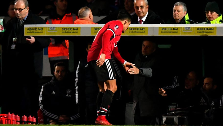 YEOVIL, ENGLAND - JANUARY 26:  Alexis Sanchez of Manchester United shakes hands with Jose Mourinho, Manager of Manchester United as he is substituted during The Emirates FA Cup Fourth Round match between Yeovil Town and Manchester United at Huish Park on January 26, 2018 in Yeovil, England.  (Photo by Dan Mullan/Getty Images)