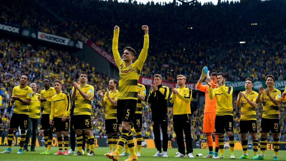 Dortmund's Spanish defender Marc Bartra (C) celebrates with his teammates after  the German first division football match between Borussia Dortmund and Werder Bremen in Dortmund, western Germany, on May 20, 2017.  / AFP PHOTO / SASCHA SCHUERMANN / RESTRICTIONS: DURING MATCH TIME: DFL RULES TO LIMIT THE ONLINE USAGE TO 15 PICTURES PER MATCH AND FORBID IMAGE SEQUENCES TO SIMULATE VIDEO. == RESTRICTED TO EDITORIAL USE == FOR FURTHER QUERIES PLEASE CONTACT DFL DIRECTLY AT + 49 69 650050         (Photo credit should read SASCHA SCHUERMANN/AFP/Getty Images)
