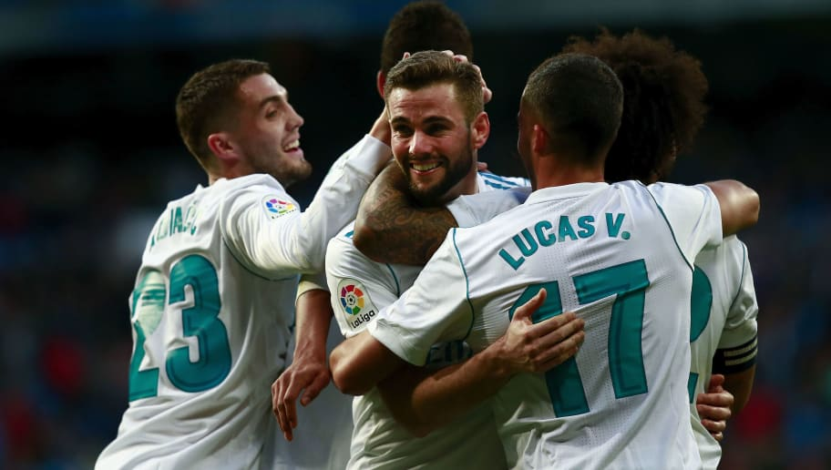 MADRID, SPAIN - JANUARY 21: Nacho Fernandez (3rdR) of Real Madrid CF celebrates scoring their seventh goal with teammates Raphael Varane (2ndL), Mateo Kovacic (L), Lucas Vazquez (2ndR) and Marcelo (R) during the La Liga match between Real Madrid CF and Deportivo La Coruna at Estadio Santiago Bernabeu on January 21, 2018 in Madrid, Spain. (Photo by Gonzalo Arroyo Moreno/Getty Images)