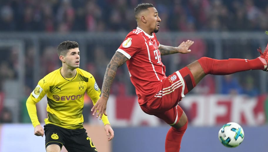 Bayern Munich's defender Jerome Boateng (R) and Dortmund's US midfielder Christian Pulisic (L) vie for the ball during the German football Cup DFB Pokal round of sixteen match Bayern Munich vs Borussia Dortmund on December 20, 2017 in Munich.  / AFP PHOTO / Christof STACHE / RESTRICTIONS: ACCORDING TO DFB RULES IMAGE SEQUENCES TO SIMULATE VIDEO IS NOT ALLOWED DURING MATCH TIME. MOBILE (MMS) USE IS NOT ALLOWED DURING AND FOR FURTHER TWO HOURS AFTER THE MATCH. == RESTRICTED TO EDITORIAL USE == FOR MORE INFORMATION CONTACT DFB DIRECTLY AT +49 69 67880   /         (Photo credit should read CHRISTOF STACHE/AFP/Getty Images)