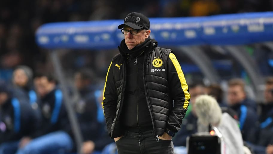 BERLIN, GERMANY - JANUARY 19:  Peter Stoeger, head coach of Dortmund looks on during the Bundesliga match between Hertha BSC and Borussia Dortmund at Olympiastadion on January 19, 2018 in Berlin, Germany.  (Photo by Stuart Franklin/Bongarts/Getty Images)