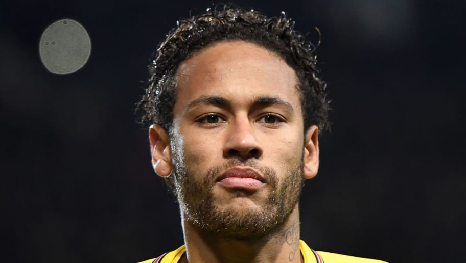 Paris Saint-Germain's Brazilian forward Neymar looks on during the French League Cup football semi-final match between Rennes and Paris Saint-Germain at the Roazhon Park stadium in Rennes on January 30, 2018. / AFP PHOTO / DAMIEN MEYER        (Photo credit should read DAMIEN MEYER/AFP/Getty Images)