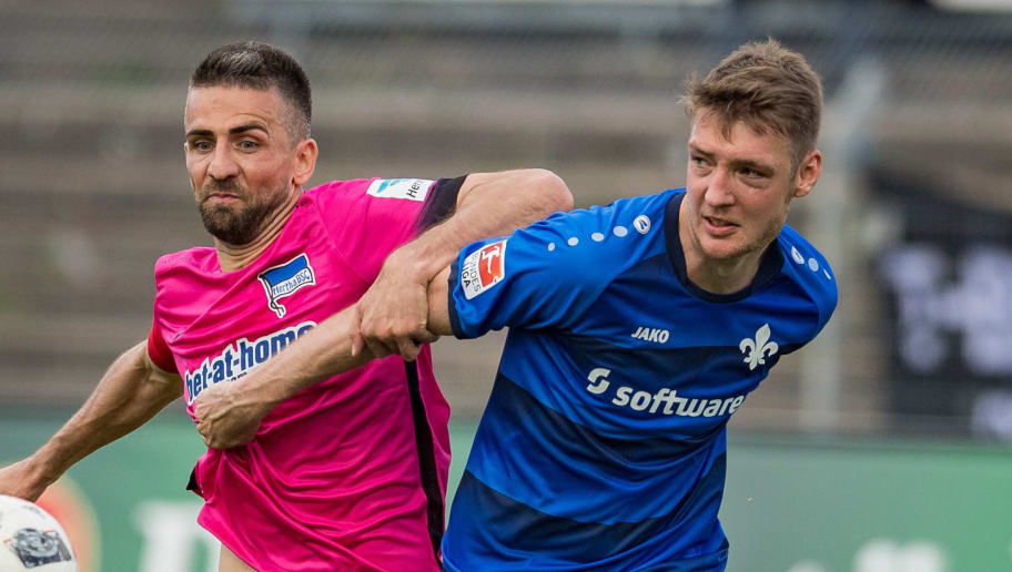 DARMSTADT, GERMANY - MAY 13: Vedad Ibisevic of Hertha BSC challenges Patrick Banggaard of Darmstadt during the Bundesliga match between SV Darmstadt 98 and Hertha BSC at Stadion am Boellenfalltor on May 13, 2017 in Darmstadt, Germany. (Photo by Alexander Scheuber/Bongarts/Getty Images)