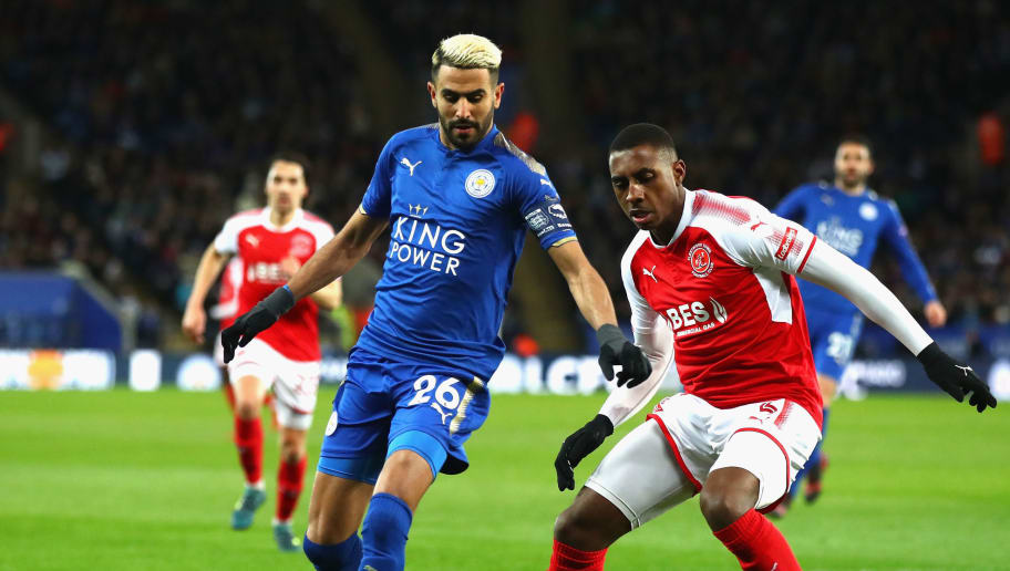 LEICESTER, ENGLAND - JANUARY 16:  Riyad Mahrez of Leicester City and Amari'i Bell of Fleetwood Town watch the ball during The Emirates FA Cup Third Round Replay match between Leicester City and Fleetwood Town at The King Power Stadium on January 16, 2018 in Leicester, England.  (Photo by Julian Finney/Getty Images )