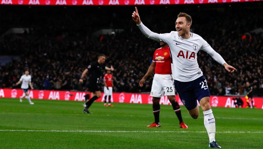Tottenham Hotspur's Danish midfielder Christian Eriksen celebrates scoring the opening goal during the English Premier League football match between Tottenham Hotspur and Manchester United at Wembley Stadium in London, on January 31, 2018. / AFP PHOTO / Adrian DENNIS / RESTRICTED TO EDITORIAL USE. No use with unauthorized audio, video, data, fixture lists, club/league logos or 'live' services. Online in-match use limited to 75 images, no video emulation. No use in betting, games or single club/league/player publications.  /         (Photo credit should read ADRIAN DENNIS/AFP/Getty Images)