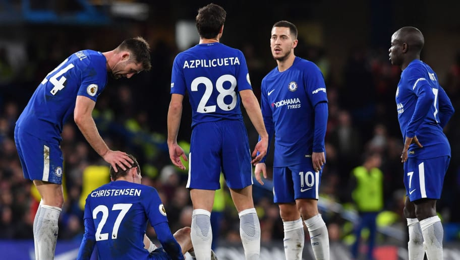 Chelsea's Danish defender Andreas Christensen (2L) sits with an injury during the English Premier League football match between Chelsea and Bournemouth at Stamford Bridge in London on January 31, 2018. / AFP PHOTO / Ben STANSALL / RESTRICTED TO EDITORIAL USE. No use with unauthorized audio, video, data, fixture lists, club/league logos or 'live' services. Online in-match use limited to 75 images, no video emulation. No use in betting, games or single club/league/player publications.  /         (Photo credit should read BEN STANSALL/AFP/Getty Images)