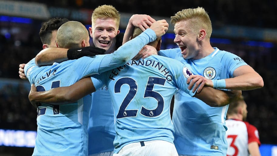 Manchester City's Brazilian midfielder Fernandinho (C) celebrates with teammates after scoring the opening goal during the English Premier League football match between Manchester City and West Bromwich Albion at the Etihad Stadium in Manchester, north west England, on January 31, 2018. / AFP PHOTO / Oli SCARFF / RESTRICTED TO EDITORIAL USE. No use with unauthorized audio, video, data, fixture lists, club/league logos or 'live' services. Online in-match use limited to 75 images, no video emulation. No use in betting, games or single club/league/player publications.  /         (Photo credit should read OLI SCARFF/AFP/Getty Images)