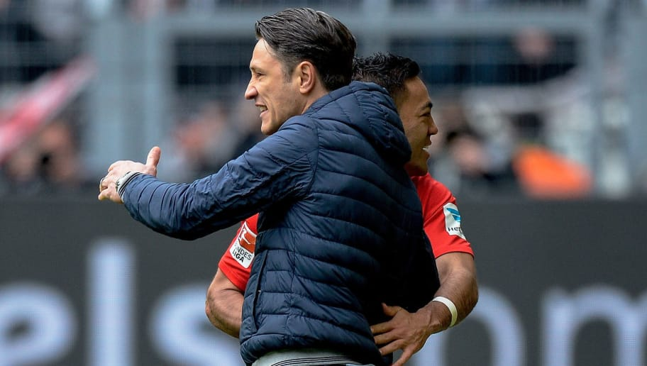 Frankfurt's Mexican midfielder Marco Fabian celebrates with Frankfurt's Croatian headcoach Niko Kovac scoring during the German First division Bundesliga football match between Borussia Dortmund and Eintracht Frankfurt in Dortmund, western Germany, on April 15, 2017. / AFP PHOTO / SASCHA SCHUERMANN / RESTRICTIONS: DURING MATCH TIME: DFL RULES TO LIMIT THE ONLINE USAGE TO 15 PICTURES PER MATCH AND FORBID IMAGE SEQUENCES TO SIMULATE VIDEO. == RESTRICTED TO EDITORIAL USE == FOR FURTHER QUERIES PLEASE CONTACT DFL DIRECTLY AT + 49 69 650050         (Photo credit should read SASCHA SCHUERMANN/AFP/Getty Images)