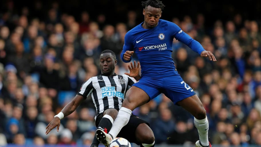 Chelsea's Belgian striker Michy Batshuayi (R) vies with Newcastle United's Senegalese midfielder Henri Saivet during the English FA Cup fourth round football match between Chelsea and Newcastle United at Stamford Bridge in London on January 28, 2018. / AFP PHOTO / Adrian DENNIS / RESTRICTED TO EDITORIAL USE. No use with unauthorized audio, video, data, fixture lists, club/league logos or 'live' services. Online in-match use limited to 75 images, no video emulation. No use in betting, games or single club/league/player publications.  /         (Photo credit should read ADRIAN DENNIS/AFP/Getty Images)