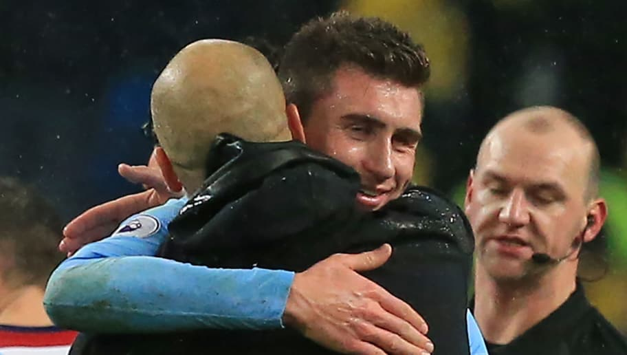 Manchester City's French defender Aymeric Laporte embraces Manchester City's Spanish manager Pep Guardiola (L) on the pitch after the English Premier League football match between Manchester City and West Bromwich Albion at the Etihad Stadium in Manchester, north west England, on January 31, 2018. Manchester City won the game 3-0. / AFP PHOTO / Lindsey PARNABY / RESTRICTED TO EDITORIAL USE. No use with unauthorized audio, video, data, fixture lists, club/league logos or 'live' services. Online in-match use limited to 75 images, no video emulation. No use in betting, games or single club/league/player publications.  /         (Photo credit should read LINDSEY PARNABY/AFP/Getty Images)