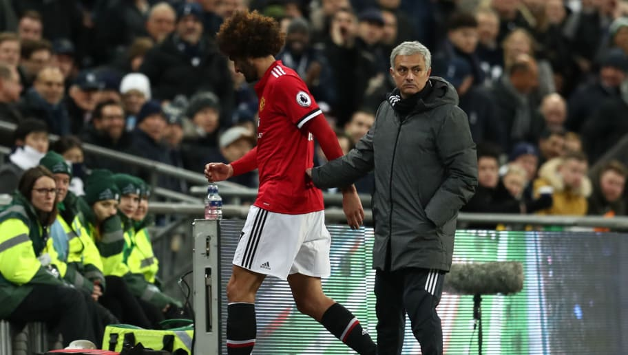LONDON, ENGLAND - JANUARY 31: Jose Mourinho the head coach / manager of Manchester United with Marouane Fellaini of Manchester United as he is substituted during the Premier League match between Tottenham Hotspur and Manchester United at Wembley Stadium on January 31, 2018 in London, England. (Photo by Catherine Ivill/Getty Images)