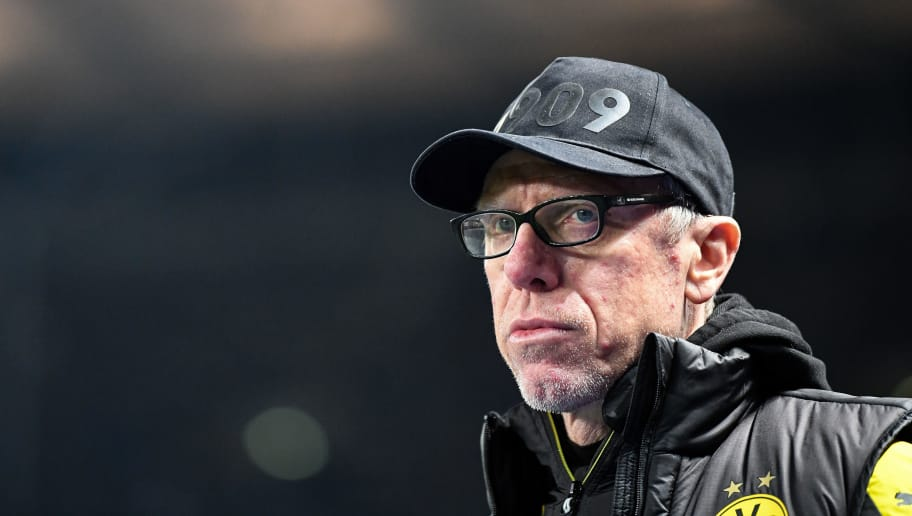 BERLIN, GERMANY - JANUARY 19: Head coach Peter Stoeger of Dortmund looks on prior the Bundesliga match between Hertha BSC and Borussia Dortmund at Olympiastadion on January 19, 2018 in Berlin, Germany. (Photo by Stuart Franklin/Bongarts/Getty Images)