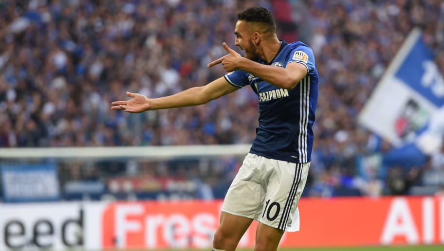 Schalke's Algerian midfielder Nabil Bentaleb celebrates during the German First division Bundesliga football match FC Schalke 04 vs VfB Stuttgart in Gelsenkirchen, western Germany, on September 10, 2017. / AFP PHOTO / PATRIK STOLLARZ / RESTRICTIONS: DURING MATCH TIME: DFL RULES TO LIMIT THE ONLINE USAGE TO 15 PICTURES PER MATCH AND FORBID IMAGE SEQUENCES TO SIMULATE VIDEO. == RESTRICTED TO EDITORIAL USE == FOR FURTHER QUERIES PLEASE CONTACT DFL DIRECTLY AT + 49 69 650050         (Photo credit should read PATRIK STOLLARZ/AFP/Getty Images)