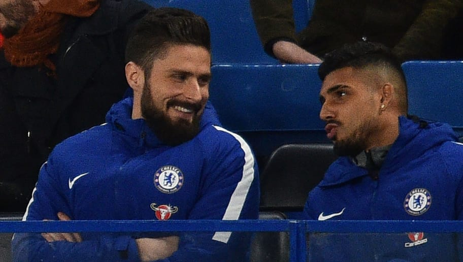 Newly-signed Chelsea striker Olivier Giroud (L) sits with the team before the English Premier League football match between Chelsea and Bournemouth at Stamford Bridge in London on January 31, 2018. / AFP PHOTO / Glyn KIRK / RESTRICTED TO EDITORIAL USE. No use with unauthorized audio, video, data, fixture lists, club/league logos or 'live' services. Online in-match use limited to 75 images, no video emulation. No use in betting, games or single club/league/player publications.  /         (Photo credit should read GLYN KIRK/AFP/Getty Images)