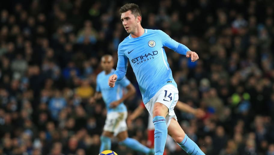 Manchester City's French defender Aymeric Laporte passes the ball during the English Premier League football match between Manchester City and West Bromwich Albion at the Etihad Stadium in Manchester, north west England, on January 31, 2018. / AFP PHOTO / Lindsey PARNABY / RESTRICTED TO EDITORIAL USE. No use with unauthorized audio, video, data, fixture lists, club/league logos or 'live' services. Online in-match use limited to 75 images, no video emulation. No use in betting, games or single club/league/player publications.  /         (Photo credit should read LINDSEY PARNABY/AFP/Getty Images)