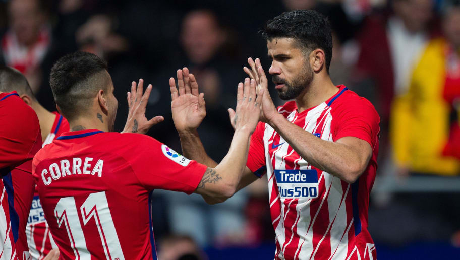 MADRID, SPAIN - JANUARY 17: Diego Costa of Atletico Madrid celebrates with Angel Correa after scoring his team's opening goal during the Copa del Rey, Quarter Final, First Leg match between Atletico de Madrid and Sevilla at Estadio Wanda Metropolitano on January 17, 2018 in Madrid, Spain. (Photo by Denis Doyle/Getty Images)