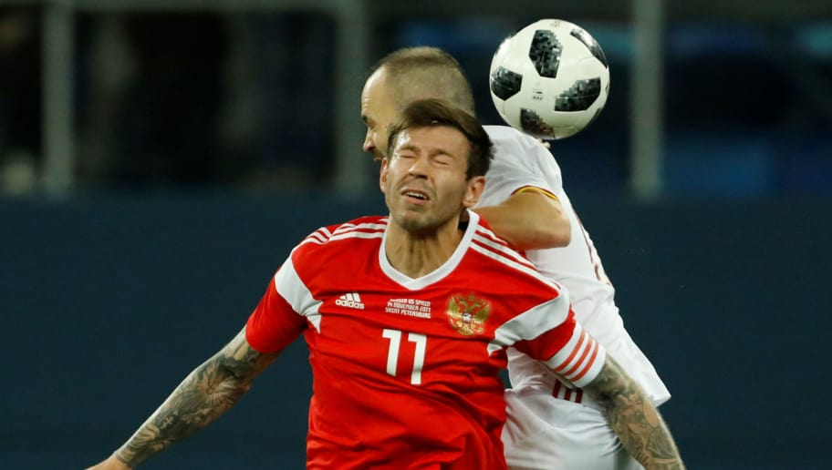 SAINT PETERSBURG, RUSSIA - NOVEMBER 14: Fedor Smolov (Front) of Russia and Andres Iniesta of Spain vie for a header during Russia and Spain International friendly match on November 14, 2017 at Saint Petersburg Stadium in Saint Petersburg, Russia. (Photo by Epsilon/Getty Images)
