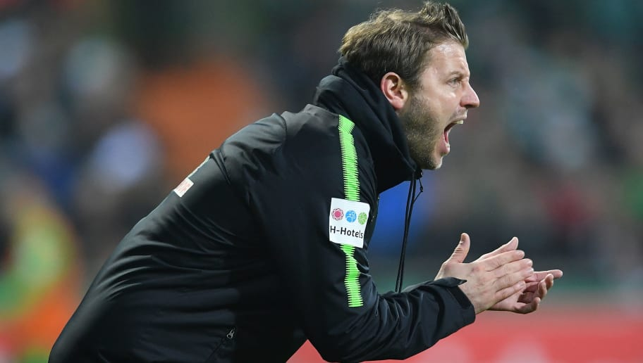 BREMEN, GERMANY - DECEMBER 20:  Florian Kohfeldt, head coach of Bremen reacts during the DFB Cup match between Werder Bremen and SC Freiburg at Weserstadion on December 20, 2017 in Bremen, Germany.  (Photo by Stuart Franklin/Bongarts/Getty Images)