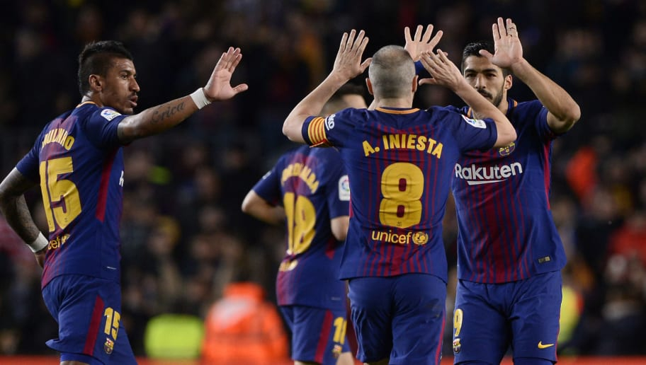 Barcelona's Uruguayan forward Luis Suarez (R) celebrates a goal with Barcelona's Spanish midfielder Andres Iniesta (2R) and Barcelona's Brazilian midfielder Paulinho during the Spanish league football match between FC Barcelona and Deportivo Alaves at the Camp Nou stadium in Barcelona on January 28, 2018. / AFP PHOTO / Josep LAGO        (Photo credit should read JOSEP LAGO/AFP/Getty Images)