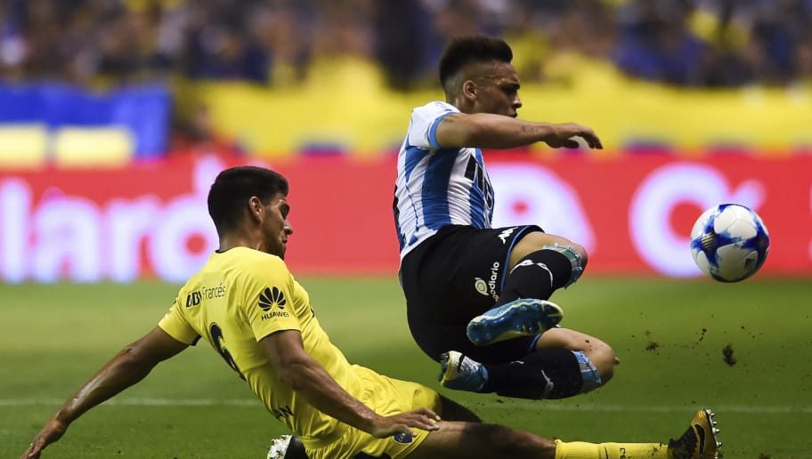 BUENOS AIRES, ARGENTINA - NOVEMBER 19: Lisandro Magallan of Boca Juniors fights for ball with Lautaro Martinez of Racing Club during a match between Boca Juniors and Racing Club as part of the Superliga 2017/18 at Alberto J. Armando Stadium on  November 19, 2017 in Buenos Aires, Argentina. (Photo by Marcelo Endelli/Getty Images)