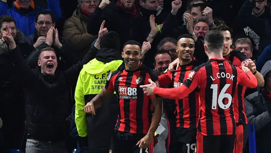 Bournemouth's English striker Callum Wilson (L) celebrates scoring the team's first goal during the English Premier League football match between Chelsea and Bournemouth at Stamford Bridge in London on January 31, 2018. / AFP PHOTO / Ben STANSALL / RESTRICTED TO EDITORIAL USE. No use with unauthorized audio, video, data, fixture lists, club/league logos or 'live' services. Online in-match use limited to 75 images, no video emulation. No use in betting, games or single club/league/player publications.  /         (Photo credit should read BEN STANSALL/AFP/Getty Images)