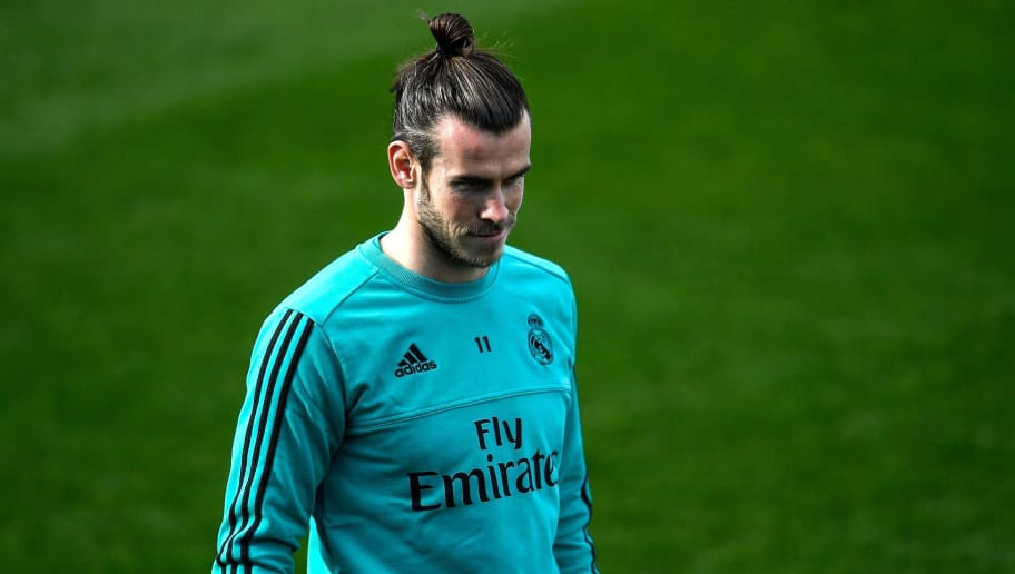 Real Madrid's Welsh forward Gareth Bale attends a training session at Valdebebas sport city in Madrid on January 26, 2018 on the eve of the Spanish League football match against Valencia.  / AFP PHOTO / OSCAR DEL POZO        (Photo credit should read OSCAR DEL POZO/AFP/Getty Images)