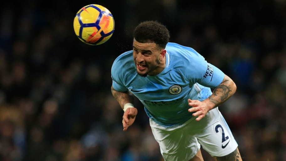 Manchester City's English defender Kyle Walker wins a header during the English Premier League football match between Manchester City and West Bromwich Albion at the Etihad Stadium in Manchester, north west England, on January 31, 2018. / AFP PHOTO / Lindsey PARNABY / RESTRICTED TO EDITORIAL USE. No use with unauthorized audio, video, data, fixture lists, club/league logos or 'live' services. Online in-match use limited to 75 images, no video emulation. No use in betting, games or single club/league/player publications.  /         (Photo credit should read LINDSEY PARNABY/AFP/Getty Images)