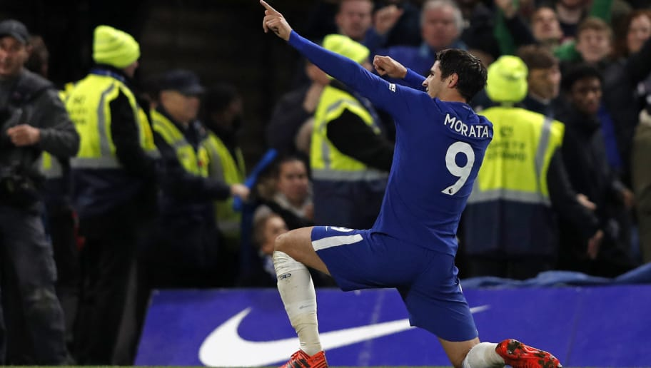Chelsea's Spanish striker Alvaro Morata celebrates scoring the opening goal during the English Premier League football match between Chelsea and Manchester United at Stamford Bridge in London on November 5, 2017. / AFP PHOTO / Adrian DENNIS / RESTRICTED TO EDITORIAL USE. No use with unauthorized audio, video, data, fixture lists, club/league logos or 'live' services. Online in-match use limited to 75 images, no video emulation. No use in betting, games or single club/league/player publications.  /         (Photo credit should read ADRIAN DENNIS/AFP/Getty Images)