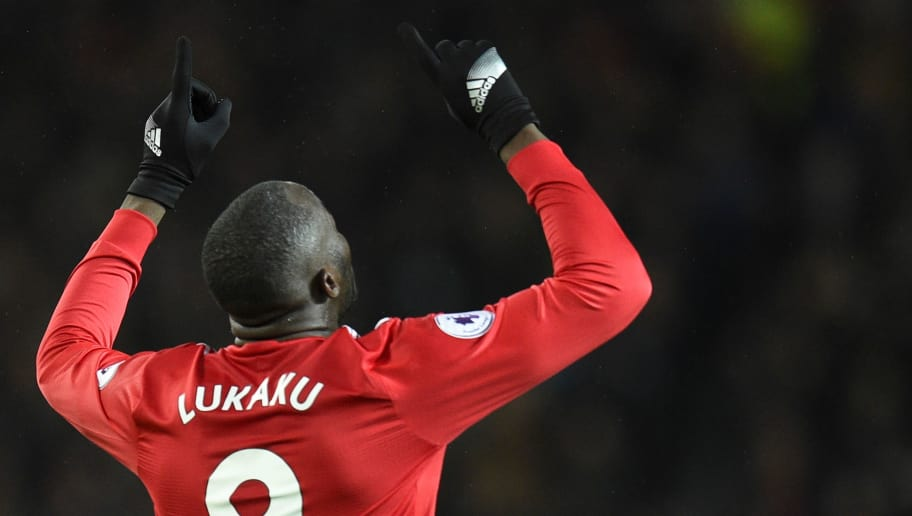 Manchester United's Belgian striker Romelu Lukaku celebrates scoring their fourth goal during the English Premier League football match between Manchester United and Newcastle at Old Trafford in Manchester, north west England, on November 18, 2017. / AFP PHOTO / Oli SCARFF / RESTRICTED TO EDITORIAL USE. No use with unauthorized audio, video, data, fixture lists, club/league logos or 'live' services. Online in-match use limited to 75 images, no video emulation. No use in betting, games or single club/league/player publications.  /         (Photo credit should read OLI SCARFF/AFP/Getty Images)