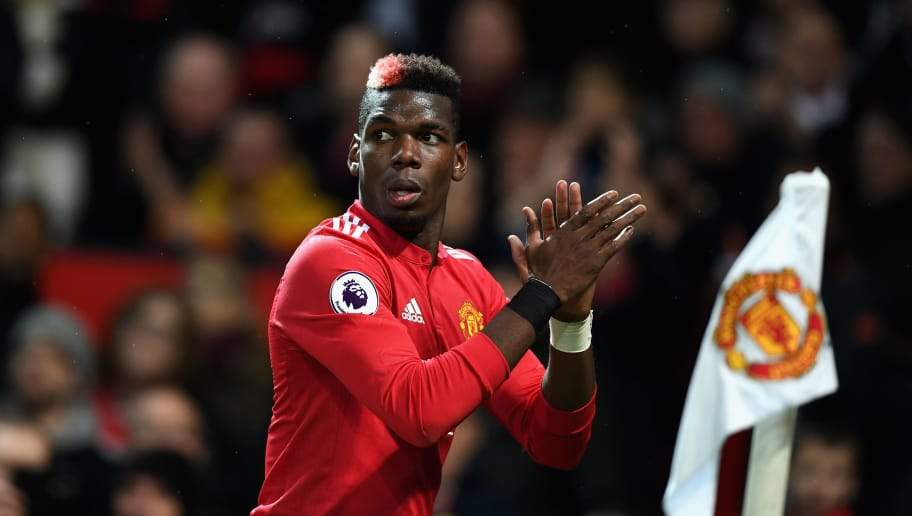 MANCHESTER, ENGLAND - NOVEMBER 18:  Paul Pogba of Manchester United celebrates when Romelu Lukaku (not pictured) scores their sides fourth goal during the Premier League match between Manchester United and Newcastle United at Old Trafford on November 18, 2017 in Manchester, England.  (Photo by Gareth Copley/Getty Images)